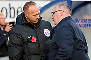 Peterborough United manager Steve Evans chatting to the fourth official Ian Cooper before the EFL Sky Bet League 1 match between Wycombe Wanderers and Peterborough United at Adams Park, High Wycombe, England on 3 November 2018.
