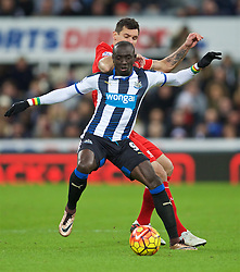 NEWCASTLE-UPON-TYNE, ENGLAND - Sunday, December 6, 2015: Liverpool's Dejan Lovren in action against Newcastle United's Papiss Cisse during the Premier League match at St. James' Park. (Pic by David Rawcliffe/Propaganda)