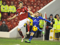 Forests DANNY COLLINS, Holds of Leicesters Jamie Vardy,  Nottingham Forest v Leicester City, City Ground Nottingham,  Sky Bet Championship, 19th Febuary 2014