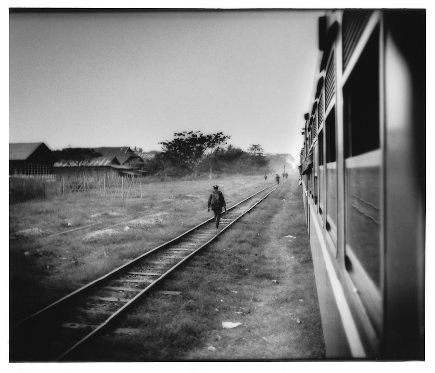 "Burmese Military patrol seen from the Mandalay to Rangoon (Yangon) ""Down"" Train near Karen Insurgency country between Taungoo and Pyu, Burma (Myanmar)."