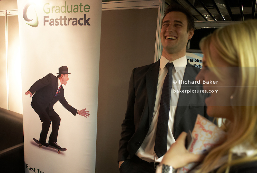 Flirting with the opposite sex at a graduate expo fair where company job recruiters meet young people starting work