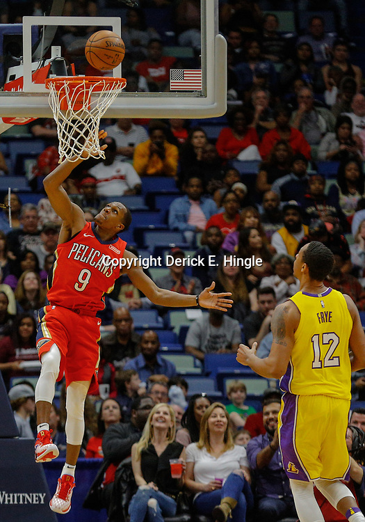 Feb 14, 2018; New Orleans, LA, USA; New Orleans Pelicans guard Rajon Rondo (9) shoots over Los Angeles Lakers forward Channing Frye (12) during the first quarter at the Smoothie King Center. Mandatory Credit: Derick E. Hingle-USA TODAY Sports