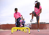 CAPE TOWN, SOUTH AFRICA - MARCH 10: Dominique Darden of Florida (USA) showing some hurdle drills to young athletes during the TrackGirlz events at University of Western Cape on March 10, 2018 in Cape Town, South Africa. (Photo by Roger Sedres/ImageSA)