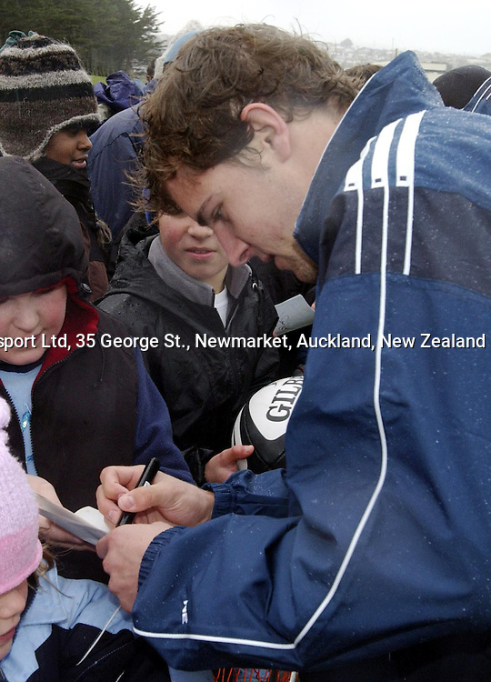Nick Evans signs autographs for fans during an All Black Training, 07 June 2004 in Dunedin, prior to the Test match against England on Saturday.<br />Please credit: Photosport