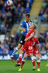 Wigan Athletic's Emyr Huws and Cardiff City's Mats Moller Daehil challenge for the header - Photo mandatory by-line: Dougie Allward/JMP - Mobile: 07966 386802 19/08/2014 - SPORT - FOOTBALL - Cardiff - Cardiff City Stadium - Cardiff City v Wigan Athletic - Sky Bet Championship