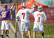 SHOT 5/11/13 5:49:36 PM - Denver's Eric Law #11 celebrates after scoring a goal with teammate Colin Scott #7 as Albany goalkeeper Blaze Riorden #10 reacts in the background during their first round NCAA Tournament lacrosse game at the Peter Barton Lacrosse Stadium on the University of Denver campus Saturday May 11, 2013. The University of Denver won the game 19-14 to advance. (Photo by Marc Piscotty / © 2013)