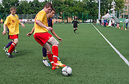 SO Austria (violet) compete with SO Russia (yellow) during the 2013 Special Olympics European Unified Football Tournament in Warsaw, Poland.<br /> <br /> Poland, Warsaw, June 06, 2012<br /> <br /> Picture also available in RAW (NEF) or TIFF format on special request.<br /> <br /> For editorial use only. Any commercial or promotional use requires permission.<br /> <br /> <br /> Mandatory credit:<br /> Photo by © Adam Nurkiewicz / Mediasport