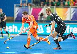 The Netherlands Seve Van Ass is watched by Niklas Wellen of Germany. The Netherlands v Germany - Final Unibet EuroHockey Championships, Lee Valley Hockey & Tennis Centre, London, UK on 29 August 2015. Photo: Simon Parker