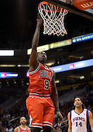 Nov. 14, 2012; Phoenix, AZ, USA; Chicago Bulls forward Luol Deng (9) lays up the ball during the game against the Phoenix Suns in the first half at US Airways Center.  The Bulls defeated the Suns 112-106 in overtime. Mandatory Credit: Jennifer Stewart-US PRESSWIRE
