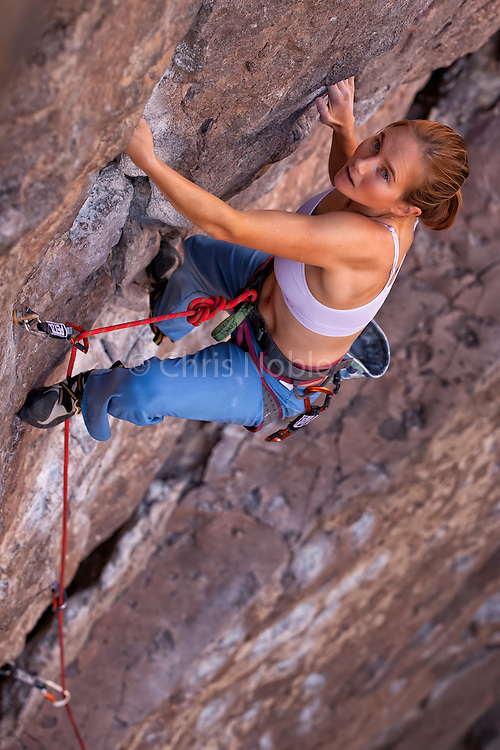 "Professional rock climber Beth Rodden leads ""Wall Banger"" rated 10c in the Owens River Gorge, Bishop California, USA."