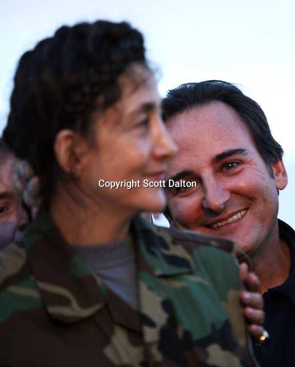 Ingrid Betancourt, who was help captive by FARC rebels for over 6 years, receives a hero's welcome to Bogotá as her husband Juan Carlos Lecompte looks on from behind, upon her arrival to Bogotá after being rescued in a Colombian military operation on July 2, 2008. (Photo/Scott Dalton)