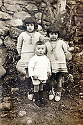 1930  children 2 5 and 8 year of age posing for a portrait