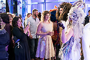 "Hair sculpture models pose for photographs wit the crowd during ""Hair Affair: The Art of Hair"" at Madison Museum of Contemporary Art in Madison, WI on Thursday, April 25, 2019. The sixth biennial brought an array of designers and stylists from across Wisconsin to create under the theme of ""Zodiac."""