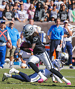 Oct 12 2014 - Oakland U.S. CA - Oakland WR # 17 Denarius Moore break away and fake out Chargers CB after a long pass during NFL Football game between San Diego Chargers and  Oakland Raiders 28-31 lost at O.co Coliseum Stadium Oakland Calif.