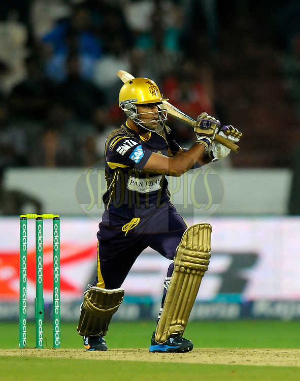 Suryakumar Yadav of Kolkata Knight Riders bats during match 7 of the Oppo Champions League Twenty20 between the Kolkata Knight Riders and the Lahore Lions held at the Rajiv Gandhi Cricket Stadium, Hyderabad, India on the 21st September 2014<br /> <br /> Photo by:  Pal Pillai / Sportzpics/ CLT20<br /> <br /> <br /> Image use is subject to the terms and conditions as laid out by the BCCI/ CLT20.  The terms and conditions can be downloaded here:<br /> <br /> http://sportzpics.photoshelter.com/gallery/CLT20-Image-Terms-and-Conditions-2014/G0000IfNJn535VPU/C0000QhhKadWcjYs