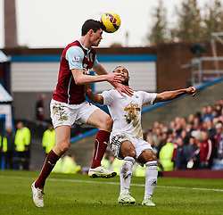 Burnley's Michael Keane clears the ball ahead of Wayne Routledge of Swansea City  - Photo mandatory by-line: Matt McNulty/JMP - Mobile: 07966 386802 - 28/02/2015 - SPORT - Football - Burnley - Turf Moor - Burnley v Swansea City - Barclays Premier League
