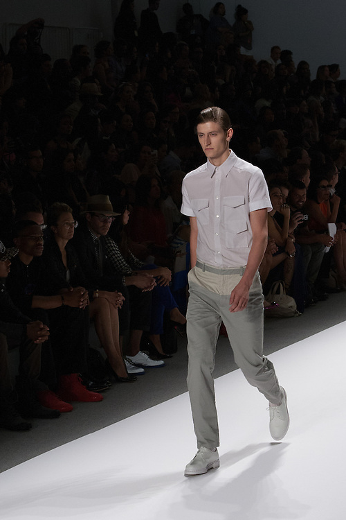 A men's outfit with sage-green two-toned tousers and camp shirt by Richard Chai at the Spring 2013 Mercedes Benz Fashion Week show in New York.