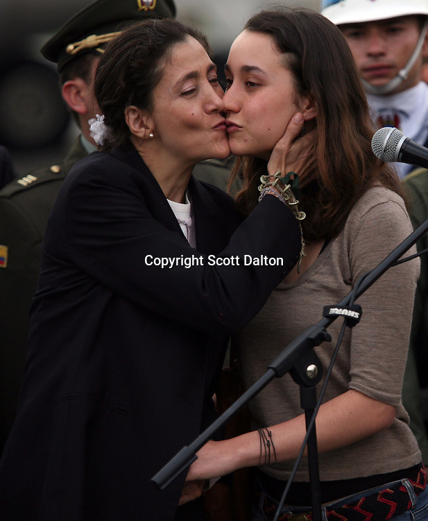 Ingrid Betancourt, left, who was help captive by FARC rebels for over 6 years before being rescued by the Colombian military, is kissed by her daughter Melanie, right, at the airport in Bogotá on July 3, 2008. (Photo/Scott Dalton)