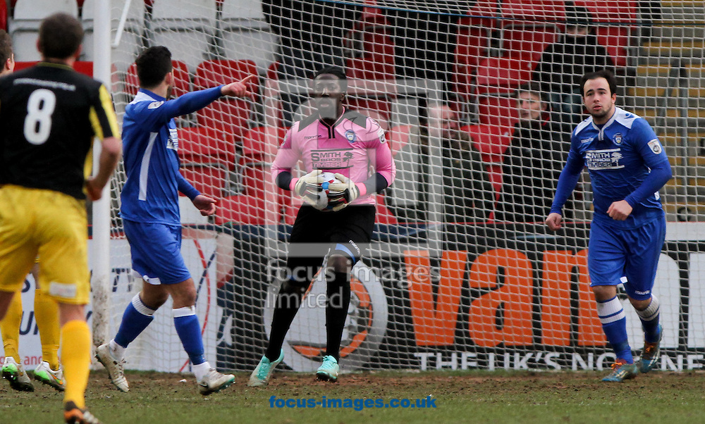 Ashlee Jones (centre) of Lowestoft Town holds onto the ball after making a save during the Conference North match at the Abbey Business Stadium, Cheltenham<br /> Picture by Tom Smith/Focus Images Ltd 07545141164<br /> 31/01/2015