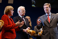 12 JAN 2003, BRAUNSCHWEIG/GERMANY:<br /> Angela Merkel (L), CDU Bundesvorsitzende, Edmund Stoiber (M), CSU, Ministerpraesident Bayern, und Christian Wulff (R), CDU Landesvorsitzender Niedersachsen, mit Handpuppen des Braunschweiger Loewen, Wahlkampfauftakt der CDU Niedersachsen zur Landtagswahl, Volkswagenhalle<br /> IMAGE: 20030112-01-061<br /> KEYWORDS: Spitzenkandidat, Ministerpr&auml;sident,