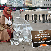 "Sabia Kamali of Islam Channel at Penny Appeal Team Orange unveiling 5 life-size ice statues ""What Would Jesus Do?"", symbolising homeless families to promote their winter campaign. The frozen family will depict the plight of the 140* families who become homeless everyday, and the 900* children who become homeless every month on 17th December at Canary Wharf, London, UK."