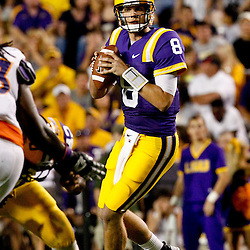 September 10, 2011; Baton Rouge, LA, USA;  LSU Tigers quarterback Zach Mettenberger (8) is pressured by Northwestern State Demons defensive tackle Lesley Deamer (93) during the second half at Tiger Stadium. LSU defeat Northwestern State 49-3. Mandatory Credit: Derick E. Hingle
