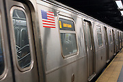 4 March 2013 - New York, NY. Q train at the Times Square subway station. Photograph by Latima Stephens/CUNY Journalism Photo