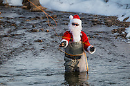 Santa Claus fishing on the Yampa River near Steamboat Springs, Colorado.