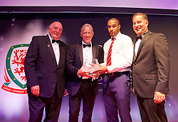 CARDIFF, WALES - Monday, October 5, 2015: Alan Curtis is presented with the FAW Long Service Award by FAW's Trefor Lloyd-Hughes, captain Ashley Williams and Vauxhall's Richard Nix during the FAW Awards Dinner at Cardiff City Hall. (Pic by David Rawcliffe/Propaganda)