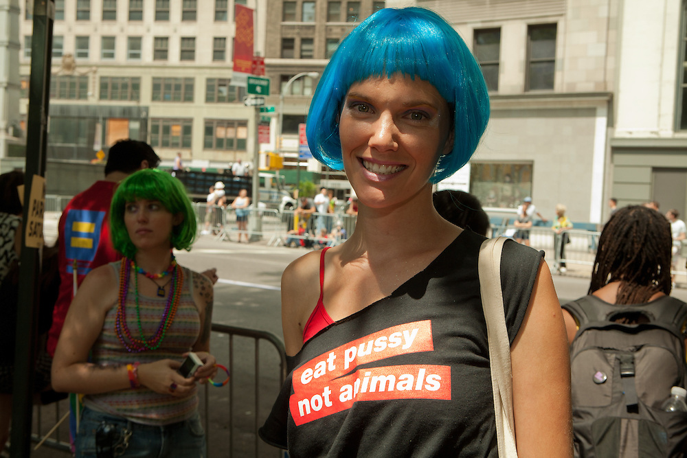 "Young woman with a message, waiting for the start of the 2011 Pride Parade, New York. She wears a tee shirt reading ""eat pussy not animals."""