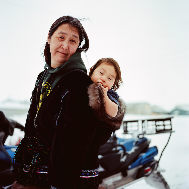 """I lost my twin sister in 1988. My daughter in there [inside the house]  is named after her. Her name is Lucy."" — Linda Soplu is ""amaq-ing"" (Inupiaq for packing) her Grandson George Soplu. Both are Inupiaq from Kaktovik, Alaska. Both Inupiat and Yup'ik have traditionally named newborn babies after people who have recently passed away. It is believed that those who have been named after those who have passed on take on characteristics of their namesake."