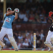 Braith Anasta and Matt Burke in action during Australia's Big Bash Cricket match to raise money for the Victorian Bushfire Appeal at the Sydney Cricket Ground, Sydney, Australia on February 22, 2009. The match was attended by over 20,000 spectators. Photo Tim Clayton