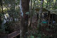 El Diamante, Meta, Colombia - 16.09.2016        <br /> <br /> A small river serves as a bath and washing area. 10th conference of the marxist FARC-EP in El Diamante, a Guerilla controlled area in the Colombian district Meta. Few days ahead of the peace contract passing after 52 years of war with the Colombian Governement wants the FARC decide on the 7-days long conferce their transformation into a unarmed political organization. <br /> <br /> Ein kleiner Fluss dient als Bad und Waschbereich. Zehnte Konferenz der marxistischen FARC-EP in El Diamante, einem von der Guerilla kontrollierten Gebiet im kolumbianischen Region Meta. Wenige Tage vor der geplanten Verabschiedung eines Friedensvertrags nach 52 Jahren Krieg mit der kolumbianischen Regierung will die FARC auf ihrer sieben taegigen Konferenz die Umwandlung in eine unbewaffneten politischen Organisation beschlie&szlig;en. <br />  <br /> Photo: Bjoern Kietzmann