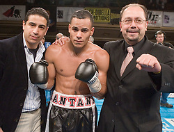 March 9, 2006 - New York, NY - Edgar Santana (c) poses with manager Ernesto Dallas (l) and PR man John Cirillo (r) after his  10 round fight against Francisco Campos at the Manhattan Center in New York City.  Santana won the bout via 7th round TKO.
