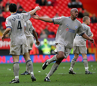 Photo:  Frances Leader.<br /> Charlton v Leicester. FA cup fifth round. <br /> The Valley<br /> 19/02/2005<br /> Leicester's Nikos Dabizas is congratulated by mate Dion Dublin for his goal against Charlton in the first half.