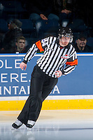 KELOWNA, CANADA - DECEMBER 3: Referee Jeff Ingram enters the ice as the Kelowna Rockets host the Saskatoon Blades on December 3, 2014 at Prospera Place in Kelowna, British Columbia, Canada.  (Photo by Marissa Baecker/Shoot the Breeze)  *** Local Caption *** Jeff Ingram;