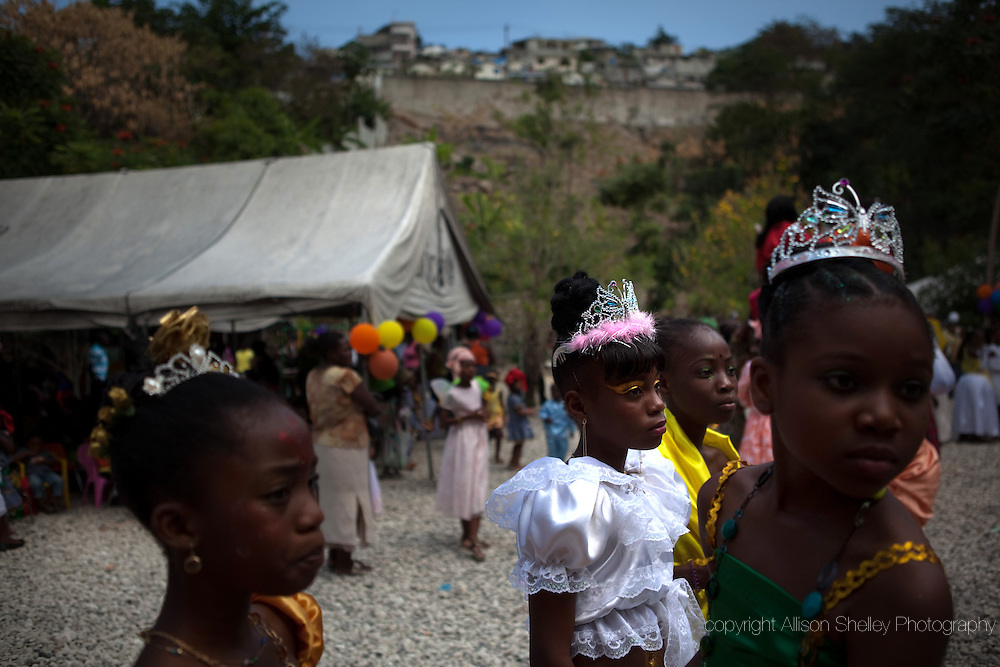 School children hold a costume party around a tent at their school in the affluent Port-au-Prince suburb of Petionville ahead of the annual  carnival celebration, March 3, 2011 in Port-au-Prince, Haiti.  Last year's celebration was cancelled due to the January 12 earthquake.