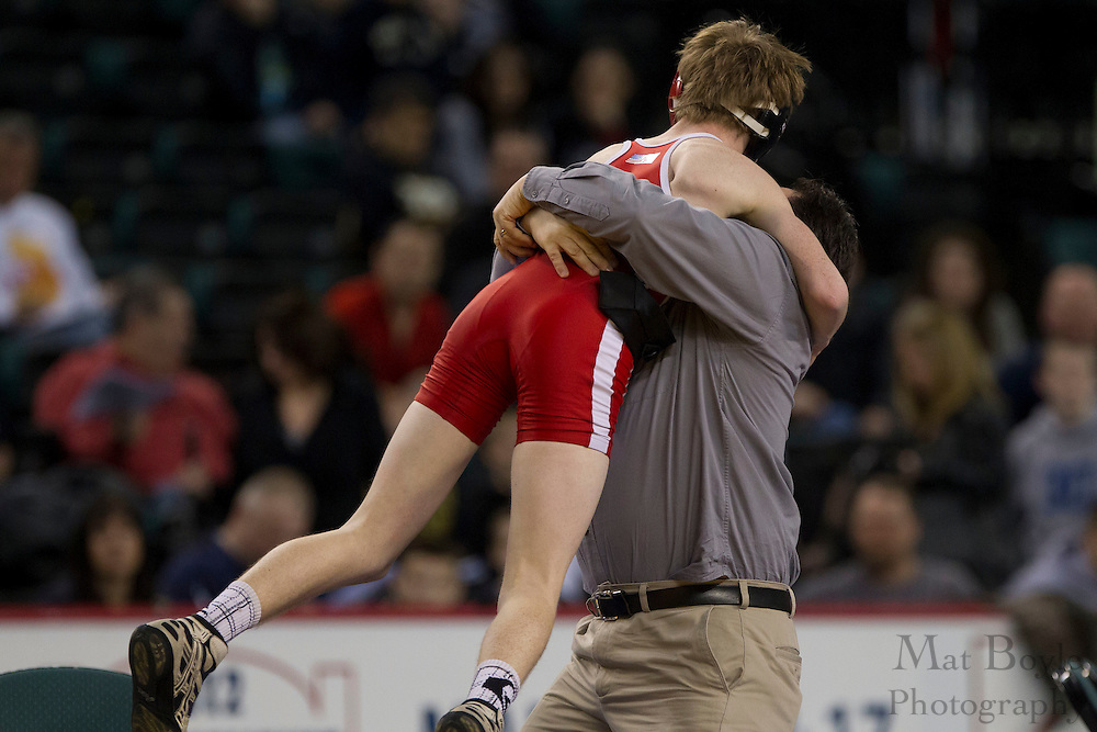 Kyle Brady celebrates his victory over Luis Gonzalez of North Bergen High School in the 113 lb weight class during the NJSIAA State Wrestling consolation matches at Boardwalk Hall in Atlantic CIty on Sunday March 4, 2012. (photo / Mat Boyle)