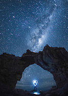 Meteor shower above the Wolfberg Arch, Cederberg Mountains, South Africa.