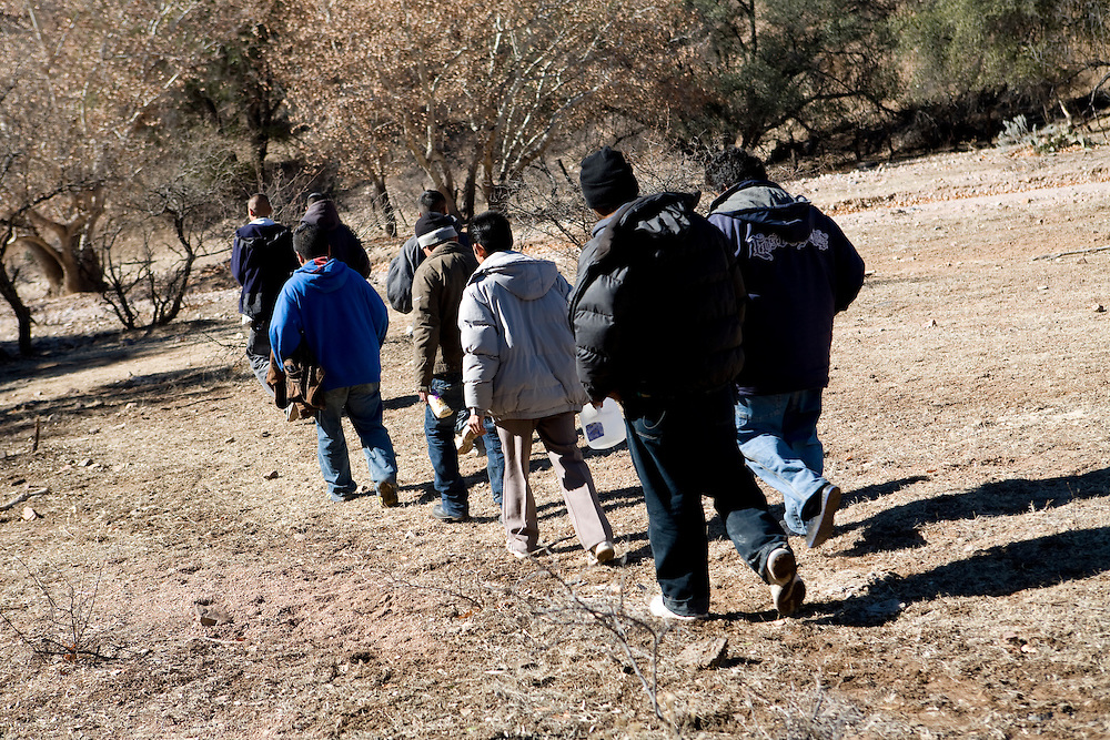 A group of migrants sets off through the desert to attempt a crossing into the United States near Nogales, Sonora, Mexico, on Friday, Feb. 1, 2008. Nogales and the surrounding desert is one of the main points of illegal crossings into the United States.