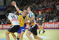 Handball EM Herren 2010 Vorrunde Deutschland - Schweden 22.01.2010 Torsten Jansen (links) und Michael Haass (rechts beide GER) gegen Lukas Karlsson (SWE Mitte)