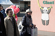 Guests walk towards the entrance of the panda booth ahead of the public debut of baby panda Xiang Xiang, born from mother panda Shin Shin on June 12, 2017, at Ueno Zoological Gardens in Tokyo, Japan December 18, 2017. 18/12/2017-Tokyo, JAPAN