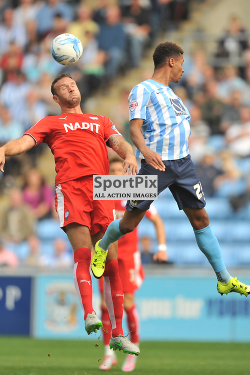 Chesterfields Ian Evatt beats Coventrys Jacob Murphy, Coventry City v Chesterfield, Football League One, Ricoh Arena Coventry Saturday 19th September 2015