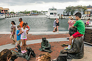"""Annapolis, Maryland - June 05, 2016: People congregate at the Kunta Kinte-Alex Haley Memorial park in historic Annapolis Sunday June 5th, 2016. Earlier that day a perigean spring tide brought some of the highest water levels of the year to the coastal town and partially flooded the park. <br /> <br /> A perigean spring tide brings nuisance flooding to Annapolis, Md. These phenomena -- colloquially know as a """"King Tides"""" -- happen three to four times a year and create the highest tides for coastal areas, except when storms aren't a factor. Annapolis is extremely susceptible to nuisance flooding anyway, but the amount of nuisance flooding has skyrocketed in the last ten years. Scientists point to climate change for this uptick. <br /> <br /> <br /> CREDIT: Matt Roth for The New York Times<br /> Assignment ID: 30191272A"""