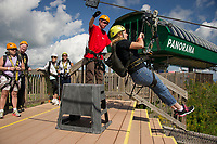 Sean Donohoe sends Renee Charlifour off on his first zip from the top of Gunstock Mountain while the rest of the Future In Sight group awaits their turn on Thursday afternoon.  (Karen Bobotas/for the Laconia Daily Sun)