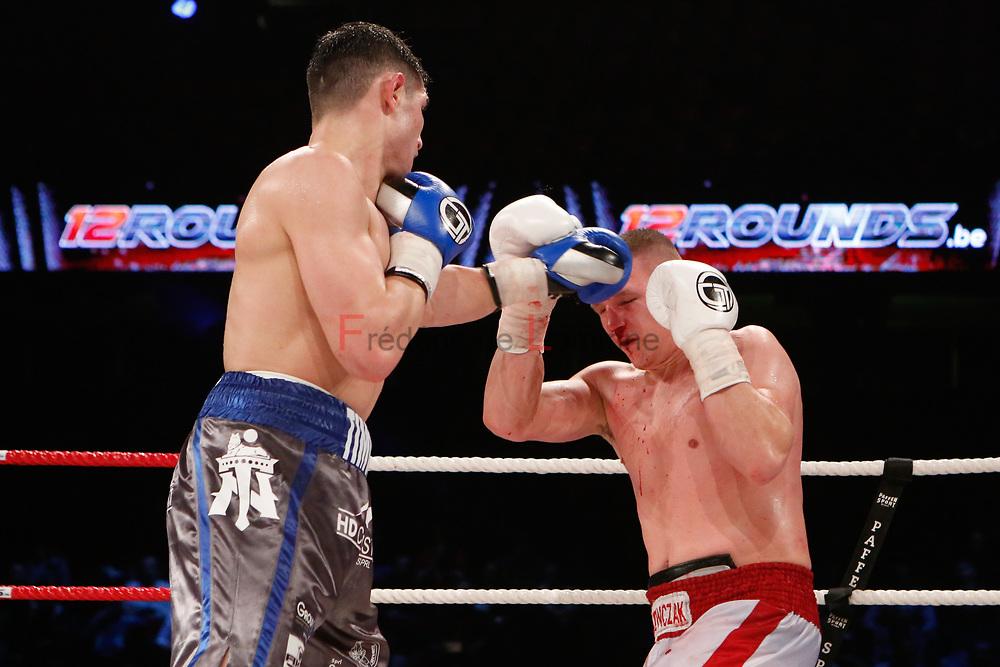 Combat Timour Nikarkhoev (ceinture bleue) – Michal Ludwiczak lors du Gala de boxe Round 5 qui s'est déroulé à Charleroi (Spiroudome) le 16/12/2017.