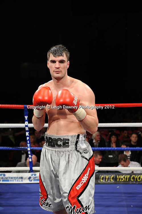 Danny Price (silver shorts) defeats John Anthony in a Cruiserweight contest on 3rd March 2012 at the Hillsborough Leisure Centre. Frank Maloney & Dennis Hobson Promotions © Leigh Dawney Photography 2012.