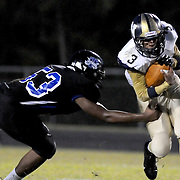 Trask's Kansas Bannerman attempts to tackle North Brunswick's Tiger Bryant Friday August 29, 2014. (Jason A. Frizzelle)