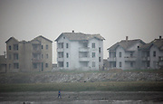 Dilapadated homes on the banks of the Yalu River, on the North Korea-China border near the town of Sunuiju, DPRK October 10, 2006. North Korea declared that it has conducted an underground nuclear test ó becoming only the eighth country to do so.  DPRK, north korea, china, dandong, border, liaoning, democratic, people's, rebiblic, of, korea, nuclear, test, rice, japan, arms, race, weapons, stalinist, communist, kin jong il