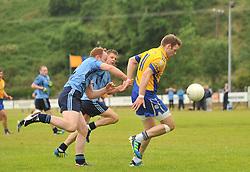 Knockmore's Aiden Kilcoyne gets past Westport Des Keane during the senior championship match. <br /> Pic Conor McKeown
